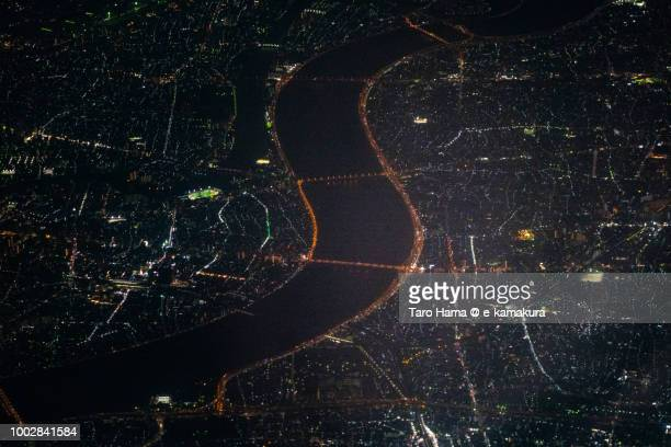 Arakawa River and Tokyo cityscape night time aerial view from airplane