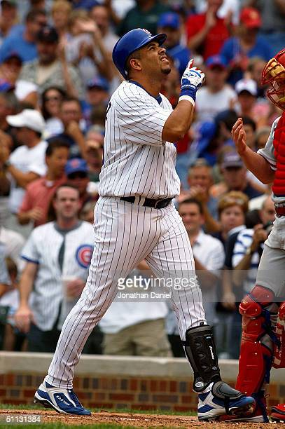 Aramis Ramirez of the Chicago Cubs points to the sky after hitting his first home run of the game in the second inning against the Philadelphia...