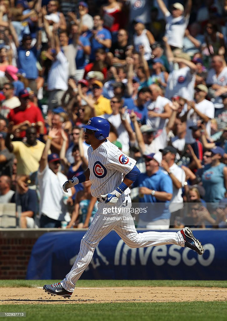 Aramis Ramirez #16 of the Chicago Cubs runs the bases after hitting the game-winning home run, a solo shot in the 8th inning, against the Philadelphia Phillies at Wrigley Field on July 16, 2010 in Chicago, Illinois. The Cubs defeated the Phillies 4-3.