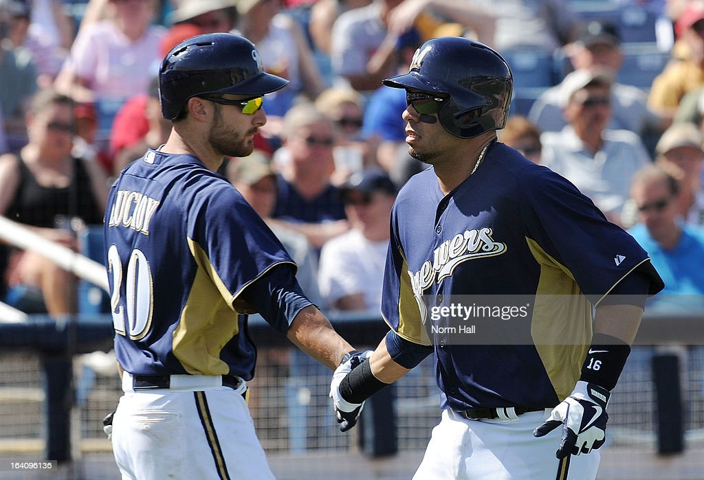 Aramis Ramirez #16 of the Milwaukee Brewers is congratulated by teammate Jonathan Lucroy #20 after hitting a home run against the Los Angeles Angels of Anaheim at Maryvale Baseball Park on March 19, 2013 in Maryvale, Arizona.