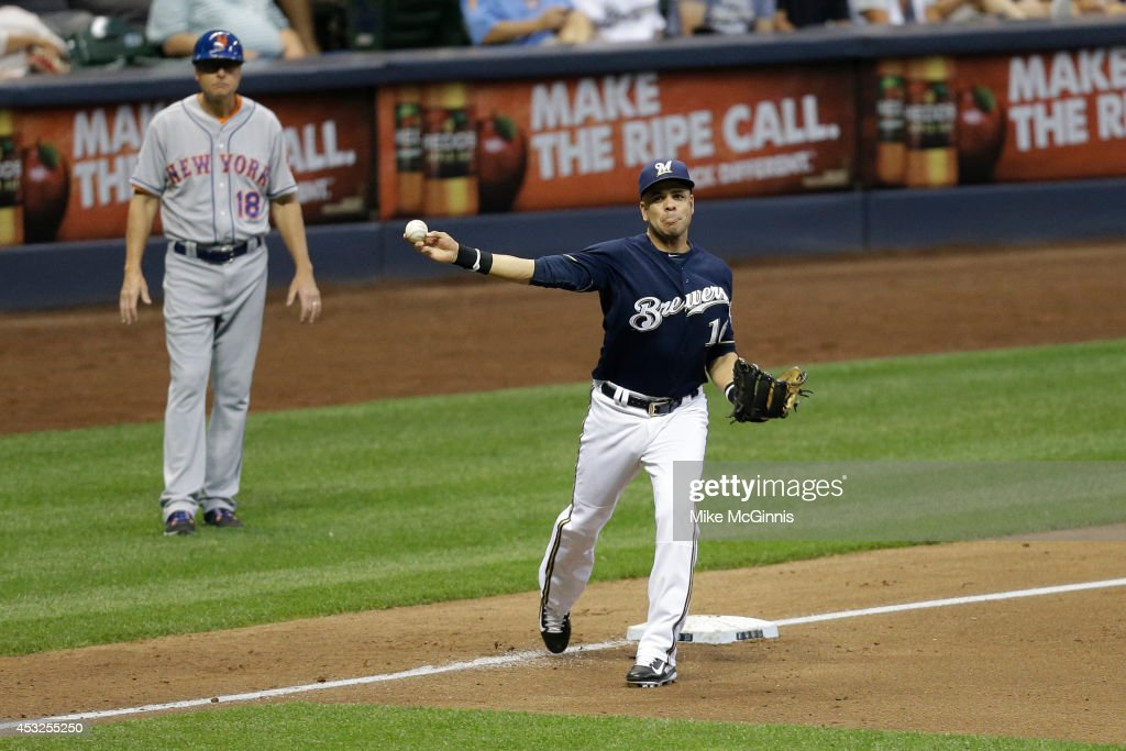 Aramis Ramirez #16 of the Milwaukee Brewers makes the throw to first base to retire David Wright of the New York Mets during the top of the seventh inning at Miller Park on July 26, 2014 in Milwaukee, Wisconsin.