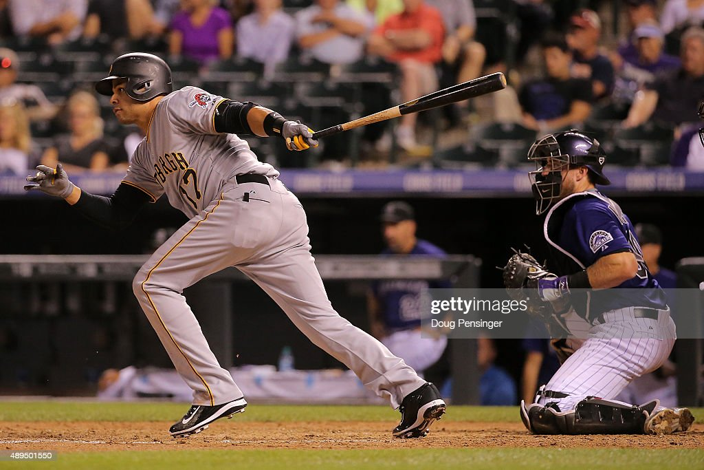 Aramis Ramirez #17 of the Pittsburgh Pirates hits an RBI single off of Brooks Brown #51 of the Colorado Rockies to take a 7-3 lead in the ninth inning at Coors Field on September 21, 2015 in Denver, Colorado. The Pirates defeated the Rockies 9-3.
