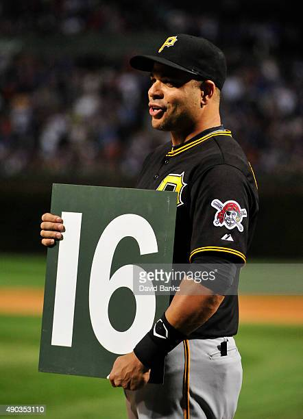 Aramis Ramirez of the Pittsburgh Pirates holds the number he wore as a Cub from the scoreboard that was presented to him by the Chicago Cubs on...