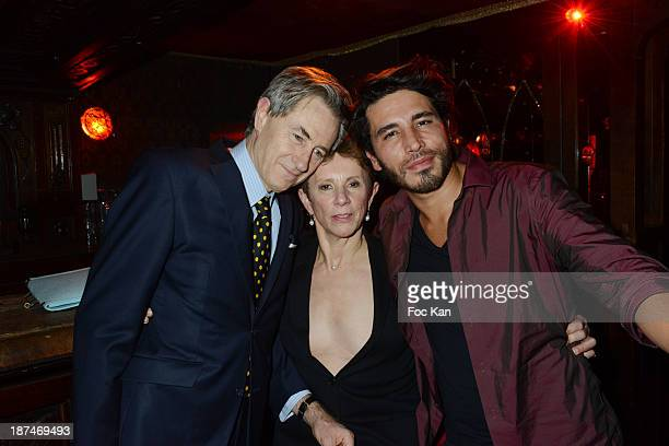 Aramy Machry his wife and Raul Higuera attend the 'Betony Vernon La Bible du Boudoir Party' At The Raspoutine Club on November 8 2013 in Paris France