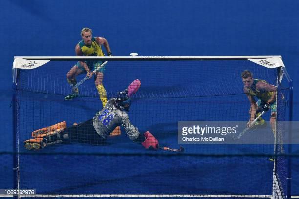 Aran Zalewski of Australia scores his team's second goal past Caiyu Wang of China during the FIH Men's Hockey World Cup Group B match between...