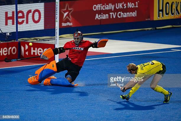 Aran Zalewski of Australia takes a penalty against goalkeeper Harmanpreet Singh of India during a shootout of the FIH Men's Hero Hockey Champions...