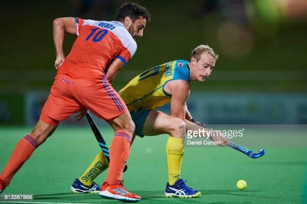 Aran Zalewski of the Kookaburras move past Valentin Verga of Holland during game three of the International Test Match hockey series between the...