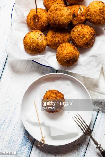 arancini on a plate - croquette stock photos and pictures