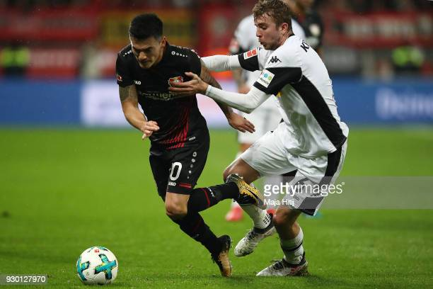 Aranguiz of Bayer Leverkusen fights for the ball with Christoph Kramer of Moenchengladbach during the Bundesliga match between Bayer 04 Leverkusen...