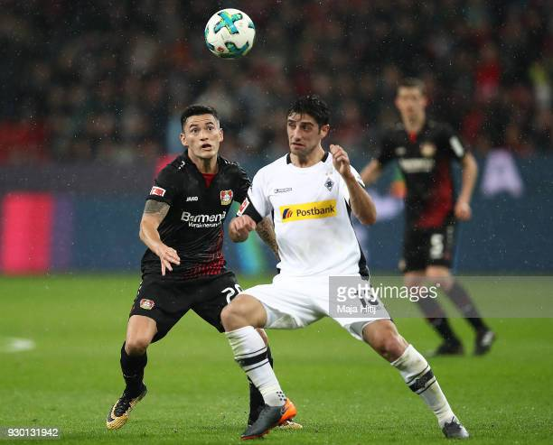 Aranguiz of Bayer Leverkusen fights for the ball with Lars Stindl of Moenchengladbach during the Bundesliga match between Bayer 04 Leverkusen and...
