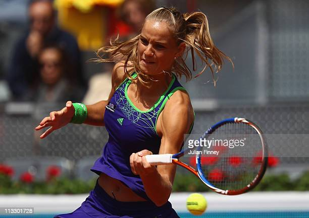 Arantxa Rus of Holland plays a forehand in her match against Maria Sharapova of Russia during day two of the Mutua Madrilena Madrid Open Tennis on...