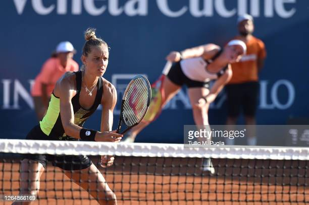 Arantxa Rus of Nederlands looks on as Tamara Zidansek of Slovenia serves to against Elisabetta Cocciaretto and Martina Trevisan of Italy during the...