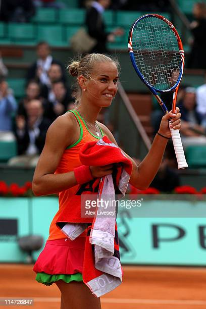 Arantxa Rus of Netherlands celebrates her victory during the women's singles round two match between Arantxa Rus of Netherlands and Kim Clijsters of...