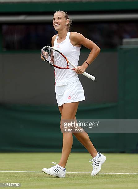 Arantxa Rus of Netherlands celebrates match point during her Ladies' singles second round match against Samantha Stosur of Australia on day three of...
