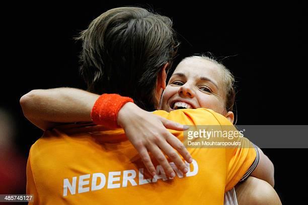 'SHERTOGENBOSCH NETHERLANDS APRIL 20 Arantxa Rus of Netherlands celebrates winning the match against Misaki Doi of Japan with captain Paul Haarhuis...