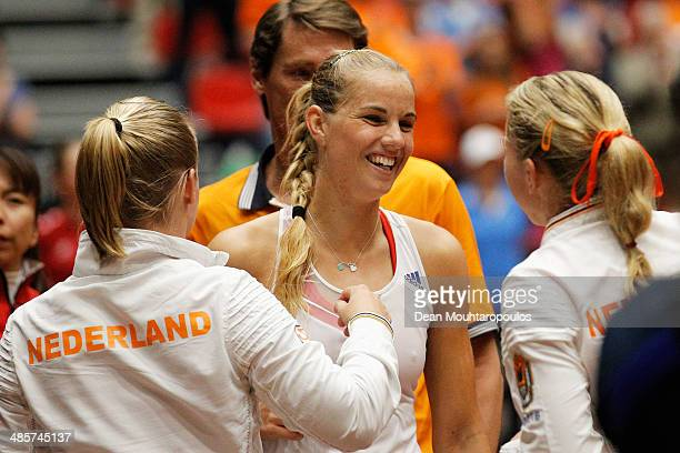 'SHERTOGENBOSCH NETHERLANDS APRIL 20 Arantxa Rus of Netherlands celebrates winning the match against Misaki Doi of Japan with captain Paul Haarhuis...