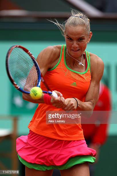 Arantxa Rus of Netherlands hits a backhand during the women's singles round two match between Arantxa Rus of Netherlands and Kim Clijsters of Belgium...