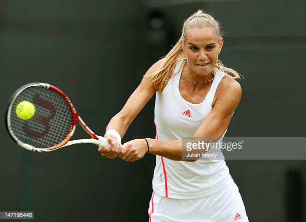 Arantxa Rus of Netherlands hits a backhand return during her Ladies' singles second round match against Samantha Stosur of Australia on day three of...