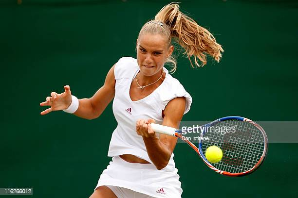 Arantxa Rus of Netherlands hits a forehand during her match against Lindsay LeeWaters of USA on day three of the Wimbledon Championships 2011...