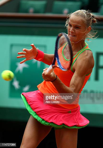 Arantxa Rus of Netherlands hits a forehand during the women's singles round two match between Arantxa Rus of Netherlands and Kim Clijsters of Belgium...