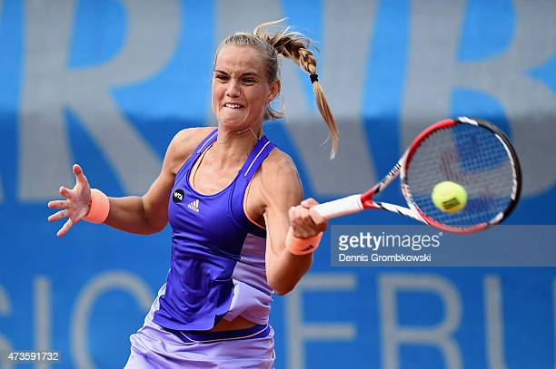 Arantxa Rus of Netherlands plays a forehand in her qualifier match against Bethanie MattekSands of the United States during the Day One of the...