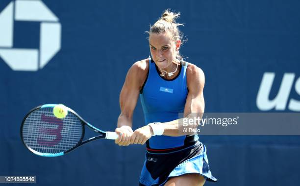 Arantxa Rus of Netherlands returns the ball during her women's singles first round match against Dominika Cibulkova of Slovakia on Day Two of the...
