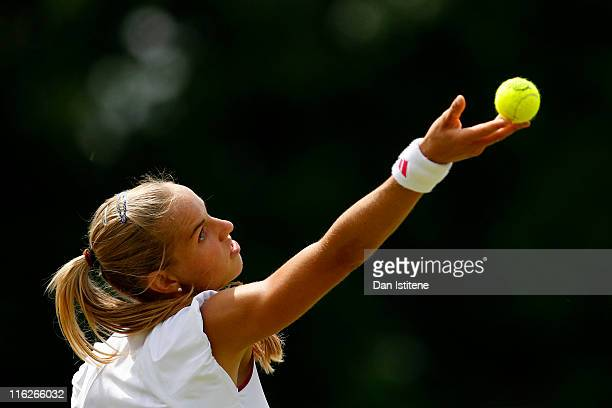 Arantxa Rus of Netherlands serves during her match against Lindsay LeeWaters of USA on day three of the Wimbledon Championships 2011 Qualifying at...