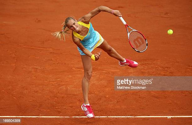 Arantxa Rus of Netherlands serves during her women's singles match against Sara Errani of Italy during day one of the French Open at Roland Garros on...