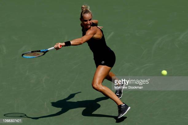 Arantxa Rus of Netherlands stretches for a shot while playing Serena Williams during the Western & Southern Open at the USTA Billie Jean King...