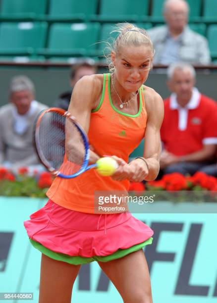 Arantxa Rus of the Netherlands in action against Kim Clijsters of Belgium in their Women's Singles Second Round match during the French Open Tennis...