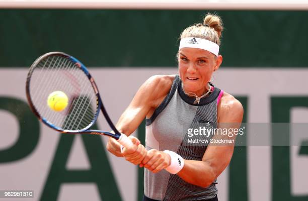 Arantxa Rus of The Netherlands plays a backhand during her ladies singles first round match against Sloane Stephens of The United States during day...
