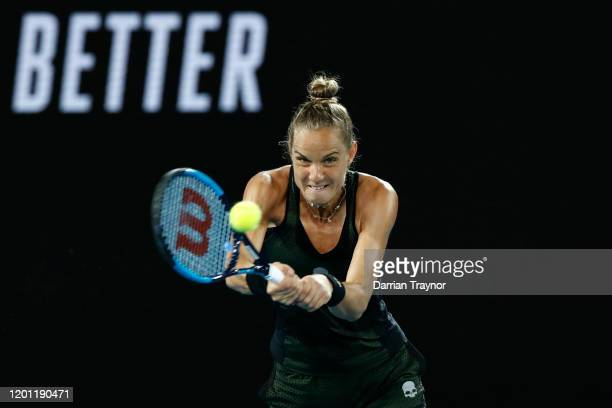 Arantxa Rus of the Netherlands plays a backhand during her Women's Singles second round match against Madison Keys of the United States on on day...