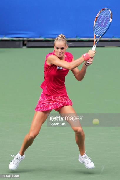 Arantxa Rus of the Netherlands plays a forehand in her match against Anastasia Pavlyuchenkova of Russia during the day one of the Toray Pan Pacific...