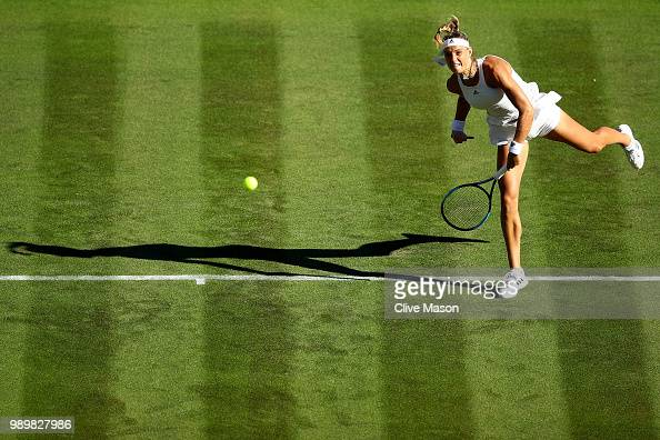 Arantxa Rus of The Netherlands serves against Serena Williams of The United States during their Ladies' Singles first round match on day one of the...