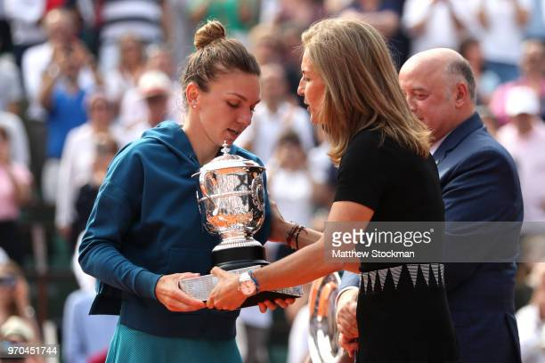 Arantxa Sanchez Vicario awards the winners trophy to Simona Halep of Romania following the ladies singles final against Sloane Stephens of The United...
