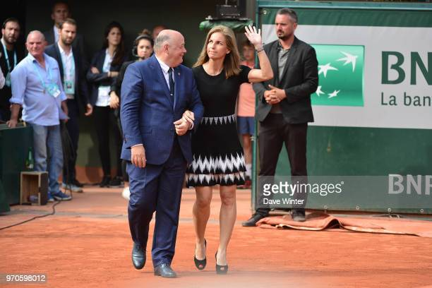 Arantxa Sanchez Vicario of Spain and President of the French Tennis Federation Bernard Giudicelli come on court to presents the Suzanne Lenglen Cup...