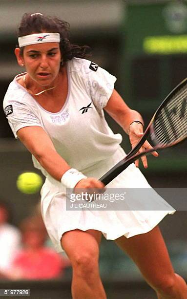 Arantxa Sanchez Vicario of Spain eyes the ball during her match against Miriam Oremans of Holland on the third day of the Wimbledon Tennis...