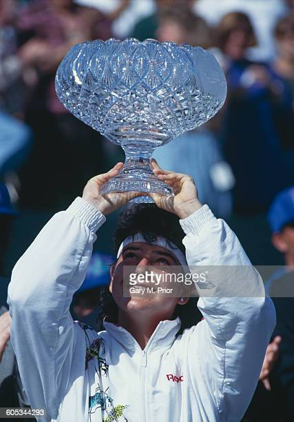 Arantxa Sanchez Vicario of Spain lifts the crystal glass trophy after winning her Women's Singles Final match against Steffi Graf at the ATP Lipton...
