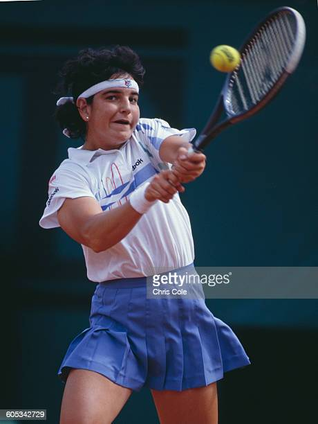 Arantxa Sanchez Vicario of Spain makes a double hand return during the Women's Singles Semi Final match against Steffi Graf at the French Open Tennis...