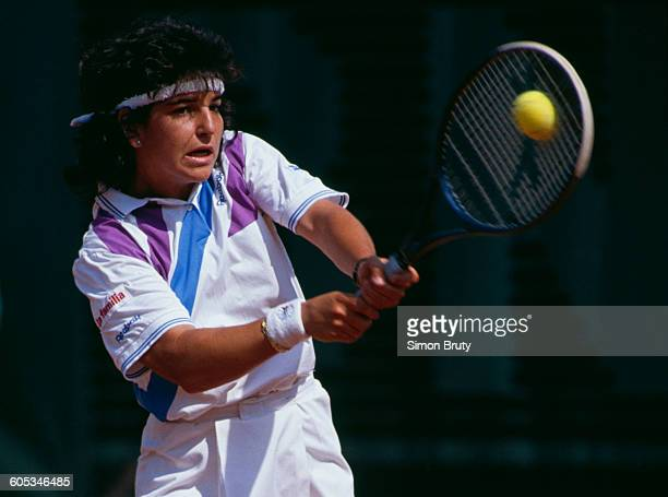Arantxa Sanchez Vicario of Spain makes a double hand return during the Women's Singles Second Round match against Mercedes Paz at the French Open...