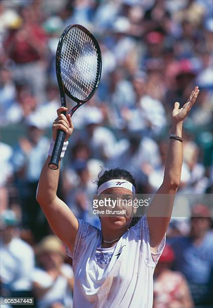 Arantxa Sanchez Vicario of Spain makes a double hand return during the Women's Singles Semi Final match against Jana Novotna at the French Open...