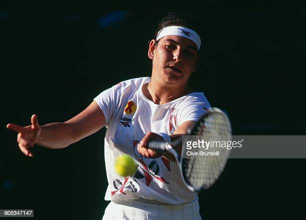Arantxa Sanchez Vicario of Spain makes a forehand return during her Women's Singles Fourth Round match against Zina Garrison at the Wimbledon Lawn...