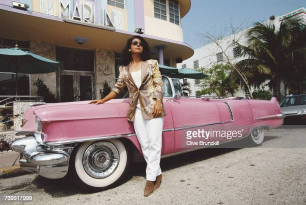 Arantxa Sanchez Vicario of Spain poses for a portrait beside a Pink Cadillac car outside The Marlin Hotel before the ATP Lipton International Players...
