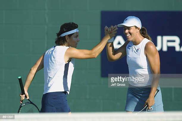 Arantxa SanchezVicario and Jennifer Capriati congratulate each other during the match against Martina Hingis and Anna Kournikova at the Acura Classic...