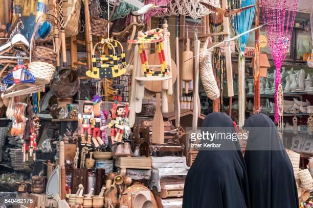 Arap women shopping in Hasircilar street, at Eminonu, Istanbul Turkey