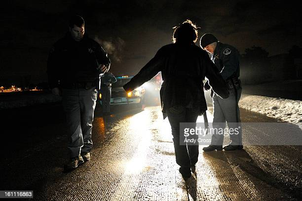 COAPRIL 18TH 2009 Arapahoe County Deputy Sheriffs Justin Osborn right and Beau Baggett left perform road side sobriety tests on Karen McNair <cq>...