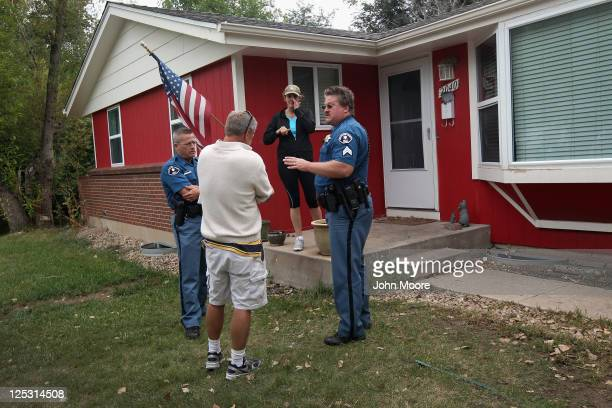 Arapahoe County sheriff's deputy Jim Osborn arrives to evict the John Holzhauer and Julie Holzhauer from their home on September 15 2011 in...