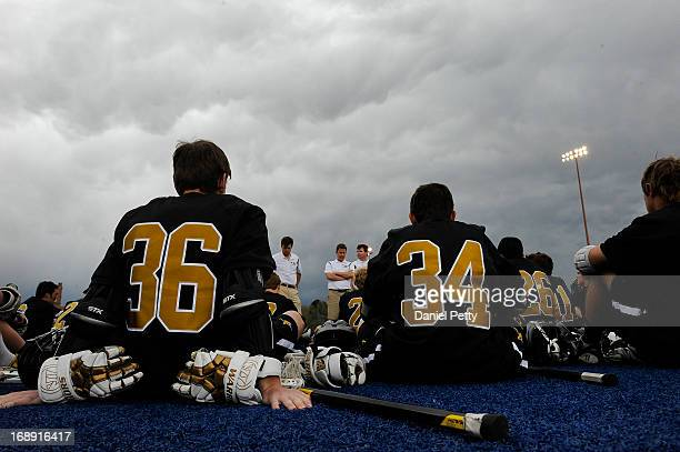 Arapahoe High School freshman midfielder Grant Evans sits with freshman midfielder Sam Cofield during halftime against Regis Jesuit during a CHSAA 5A...