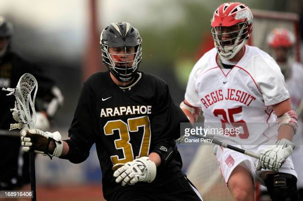 Arapahoe High School junior attacker Brendan Till competes against Regis Jesuit sophomore midfielder Conor Shea during a CHSAA 5A boys lacrosse...