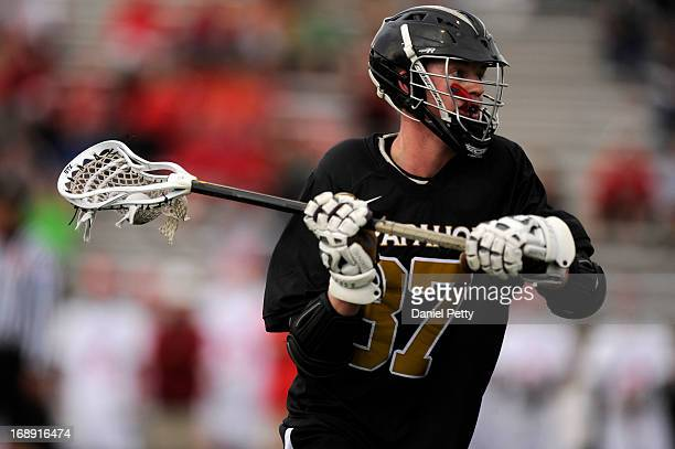 Arapahoe High School junior attacker Brendan Till looks to pass against Regis Jesuit during a CHSAA 5A boys lacrosse semifinal game on May 15 in...